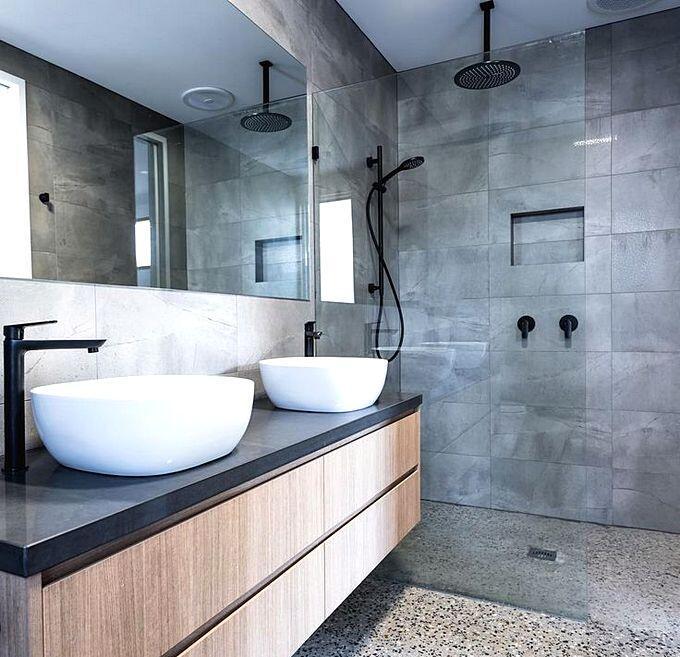 Дизайн ванной комнаты с отделкой под бетон