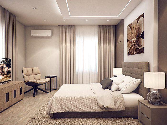 Красивый дизайн спальной комнаты в розово-серых тонах