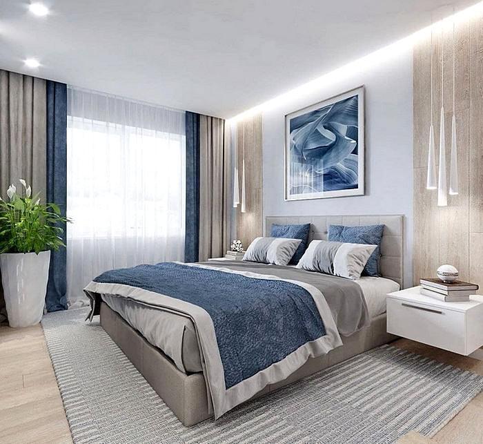Красивый дизайн спальной комнаты в голубых тонах